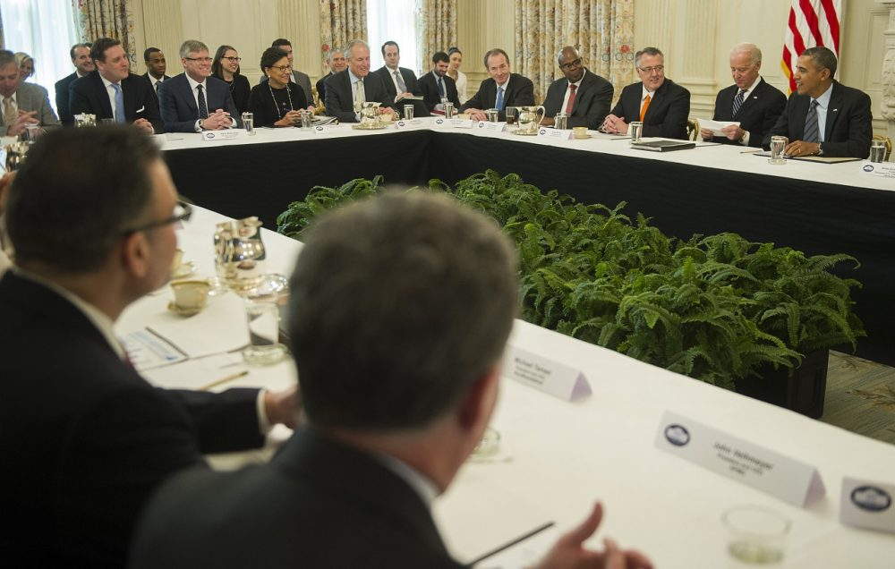 U.S. President Barack Obama and Vice President Joe Biden meet with a group of CEOs and other leaders supporting best practices for hiring the long-term unemployed at the White House in Washington, DC, January 31, 2014. (Jim Watson/AFP/Getty Images)