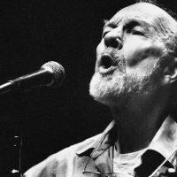 Folk singer Pete Seeger sings in a one-man benefit concert in Berkeley, Calif. on Feb. 25, 1984. Seeger died Monday, Jan. 27, 2014, at age 94. (Mark Costantini/AP)