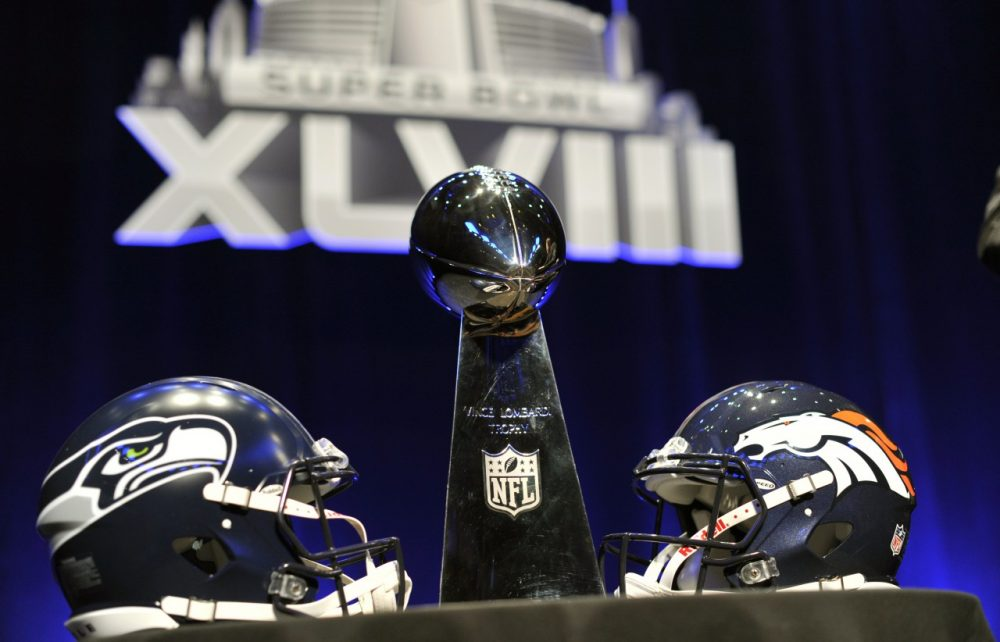 The Vince Lombardi Trophy and helmets for the Seattle Seahawks and  Denver Broncos are displayed prior to a Super Bowl XLVIII head coach joint press conference at the Rose Theater in Jazz at Lincoln Center on January 31, 2014 in New York. (Timothy Clary/AFP/Getty Images)