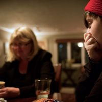 Nate, right, and his mother Jackie. (Jesse Costa/WBUR)