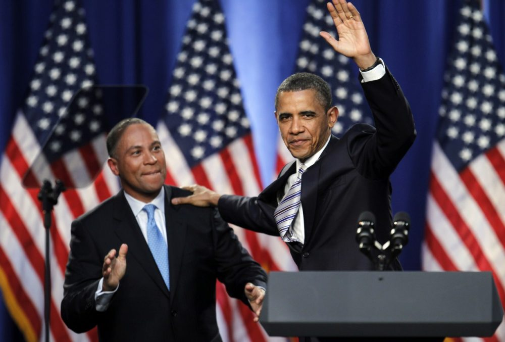 President Barack Obama, right, waves while Massachusetts Gov. Deval Patrick, left, applauds as Obama takes the stage during a campaign fundraising event, in Boston, Wednesday, May 18, 2011. Patrick introduced Obama at the event. (AP)