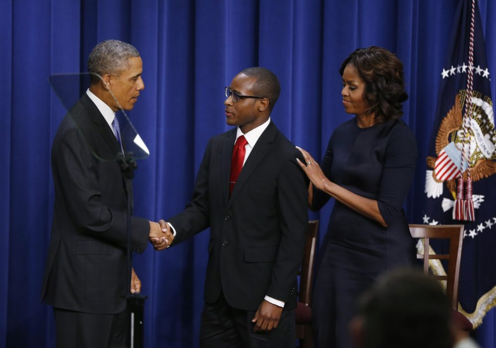 President Barack Obama and first lady Michelle Obama shake hands with Troy Simon, a New Orleans native who couldn't read until he was 14, and college graduate, after Obama spoke about college education at the Eisenhower Executive Office Building across from the White House in Washington, Thursday, Jan. 16, 2014. The event which is to promote opportunities for students to attend and finish college and university, was attended by college and university presidents and leaders from nonprofits, foundations, governments and businesses. (AP)