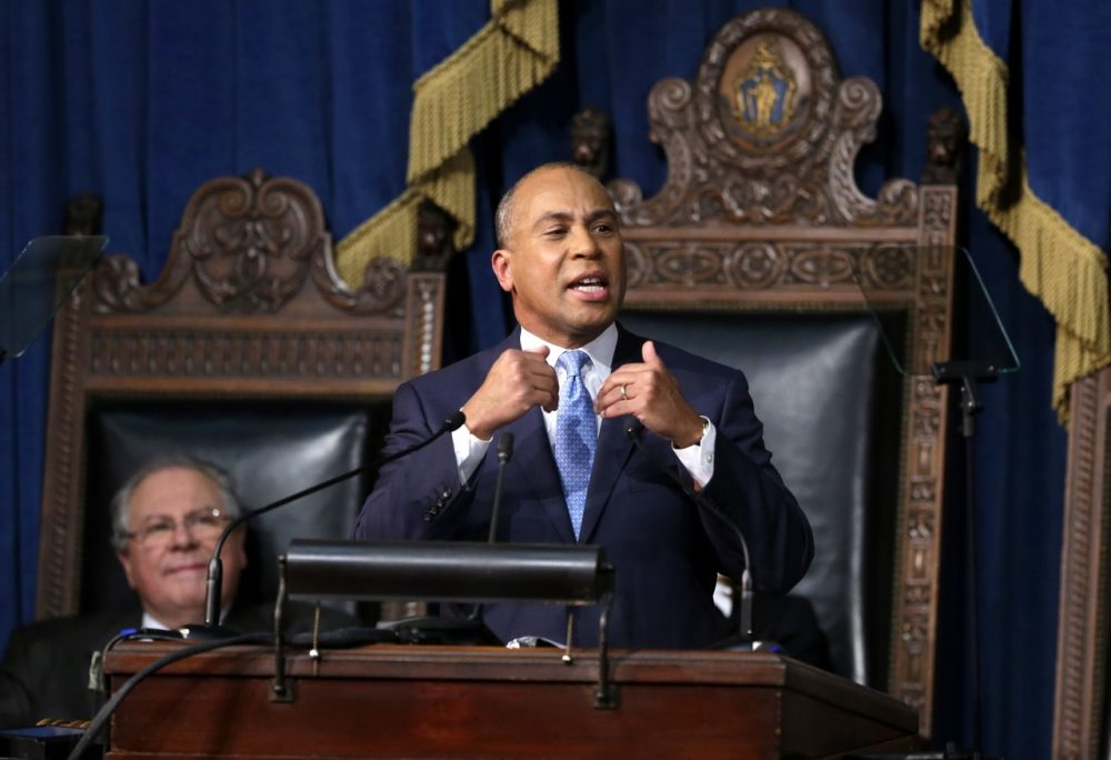 Massachusetts Gov. Deval Patrick, right, delivers his State of the State address in the House chamber at the Statehouse, Tuesday, Jan. 28, 2014, in Boston. While the economy continues to recover, the governor says many people in the state are still being left behind. Mass. Speaker of the House Robert DeLeo is seated at left. (AP)