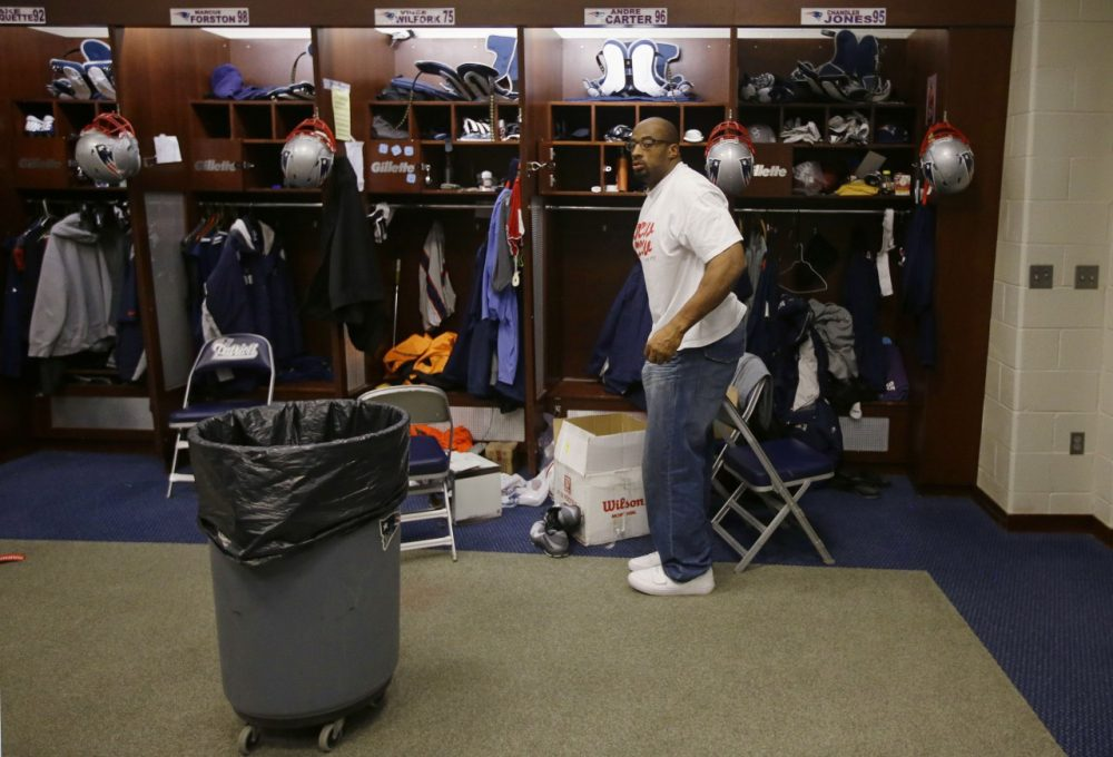New England Patriots defensive end Andre Carter packs up his locker at the NFL football team's facility in Foxborough, Mass., Monday, Jan. 20, 2014. The Patriots lost to the Denver Broncos in the AFC Championship game Sunday in Denver ending their season. (AP)