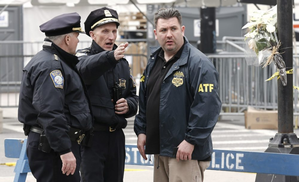 Boston Police Superintendent William Evans, center, talks with an ATF agent at a barricade near the finish line of the Boston Marathon in Boston Tuesday, April 16, 2013. (AP/Winslow Townson)