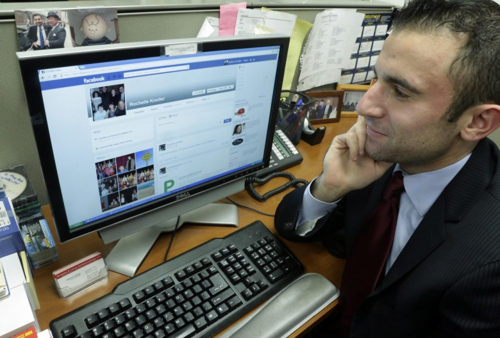 Joshua Knoller looks at the Facebook page of his mother, Rochelle. (AP/Richard Drew)
