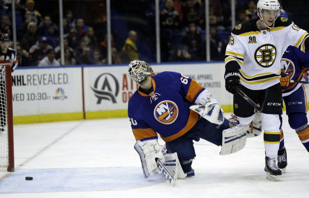 New York Islanders goalie Kevin Poulin, left, and Boston Bruins' Reilly Smith react as Boston Bruins' Zdeno Chara scores. (AP/Seth Wenig)