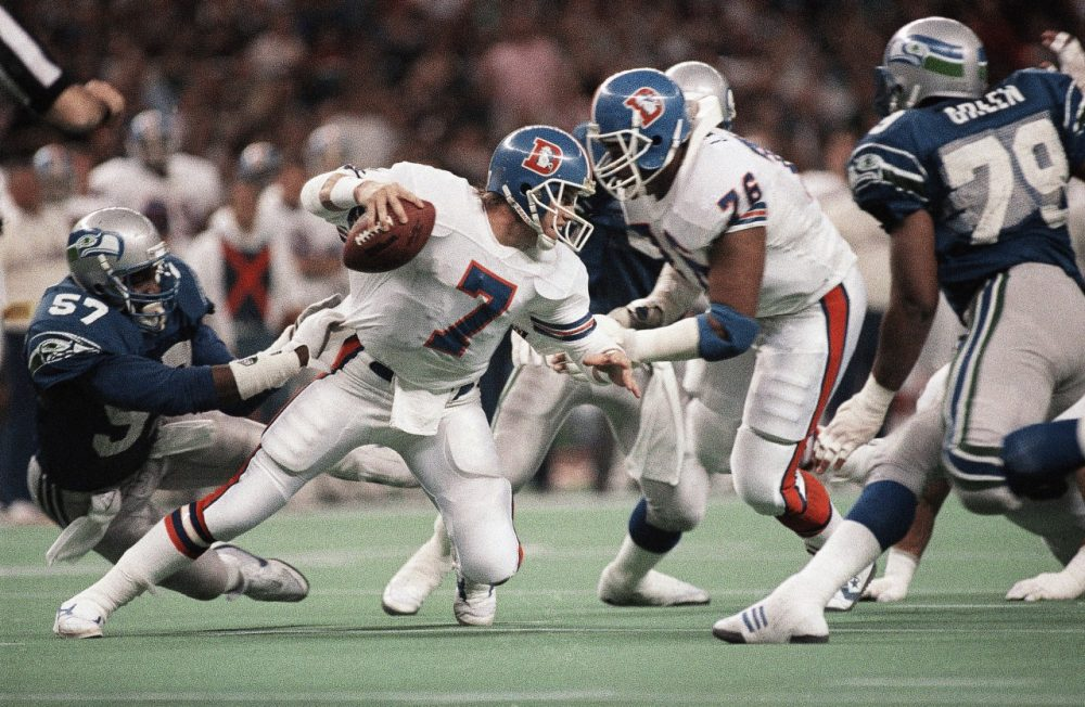 When John Elway quarterbacked the Broncos from 1983 to 1998, Denver and Seattle were AFC West Division rivals. (Barry Sweet/AP)