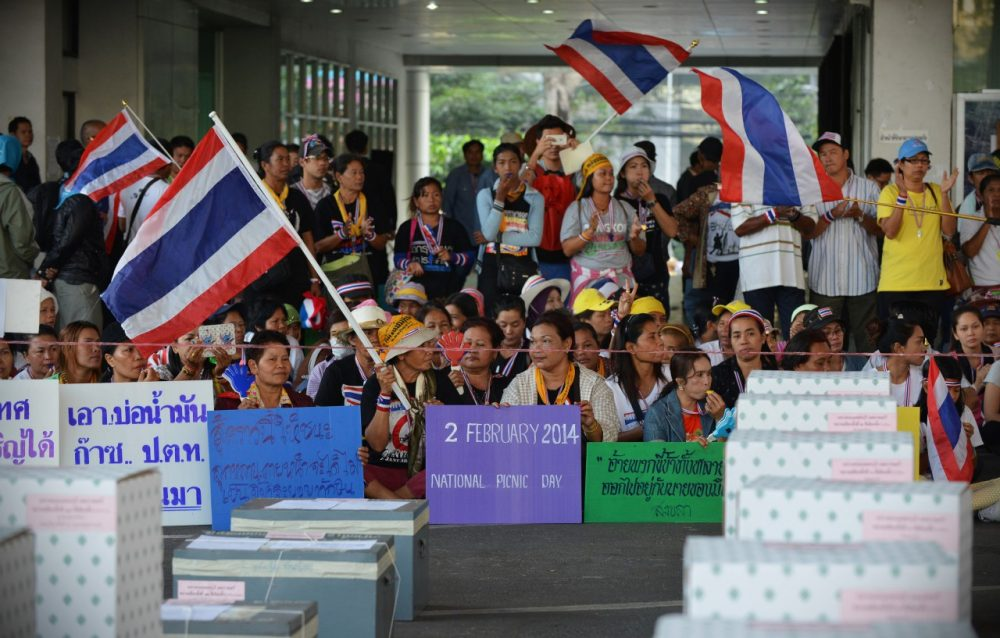 Anti-government protesters gather in front of ballot boxes in preventing voting at a polling station during Thailand's general election on February 2, 2014 in Bangkok, Thailand. (Rufus Cox/Getty Images)