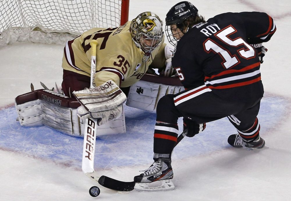 Boston College goalie Parker Milner, left, makes a stick save on a shot by Northeastern forward Kevin Roy during the third period of the championship game at the Beanpot tournament in Boston, Monday, Feb. 11, 2013. (AP/Charles Krupa)