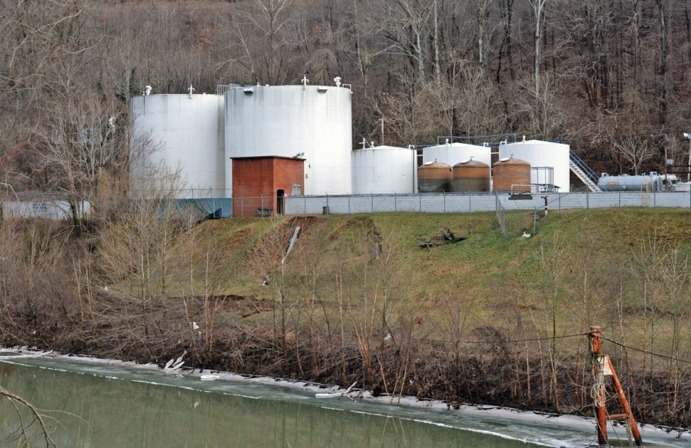 Freedom Industries is pictured on the banks of the Elk River, January 10, 2014, in Charleston, West Virginia. West Virginia American Water determined MCHM chemical had 'overwhelmed' the plant's capacity to keep it out of the water from a spill at Freedom Industries in Charleston. An unknown amount of the hazardous chemical contaminated the public water system for potentially 300,000 people in West Virginia. (Tom Hindman/Getty Images)