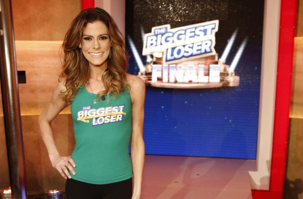 """This Feb. 4, 2014 photo released by NBC shows Rachel Frederickson on the finale of """"The Biggest Loser,"""" in Los Angeles. Fredrickson lost nearly 60 percent of her body weight to win the latest season of """"The Biggest Loser"""" and pocket $250,000. (Trae Patton/NBC via AP)"""