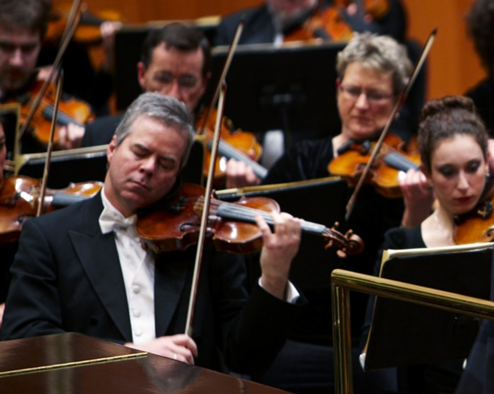 In this undated photo provided by the Milwaukee Symphony Orchestra, concertmaster Frank Almond plays a 300-year-old Stradivarius violin that was on loan to him during a concert in Milwaukee. (Milwaukee Symphony Orchestra via AP)