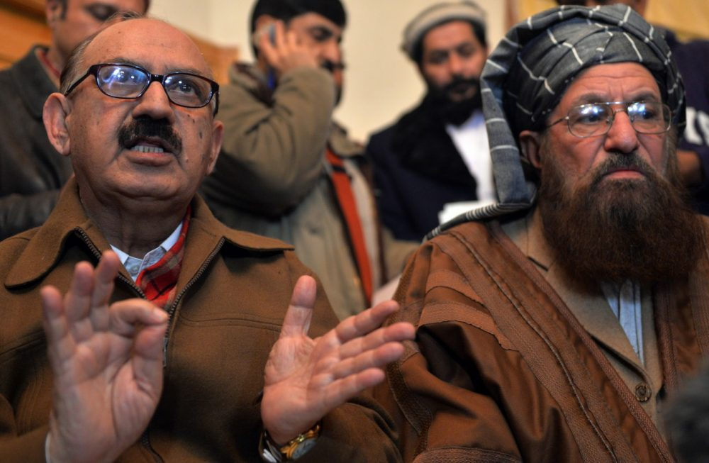 Tehreek-e-Taliban Pakistan committee member and senior religious party leader Maulana Sami-ul-Haq (right) looks on as Special Assistant to Pakistan's prime minister Irfan Siddiqui (left) speaks during a joint press conference following their meeting at the Khyber Pakhtunkhwa House in Islamabad on February 6, 2014. (Aamir Qureshi/AFP/Getty Images)