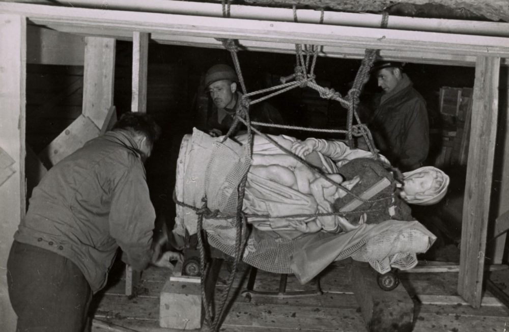 """This 1945 handout photo provided by the Smithsonian Institution shows the rescuing of Michelangelo's Madonna and Child in Altaussee, Austria. Photographs, maps and records from the real corps of soldiers known as """"Monuments Men"""" who were tasked with protecting European cultural sites and recovering looted art during World War II are going on display in Washington, many for the first time. (Smithsonian Institution via AP)"""
