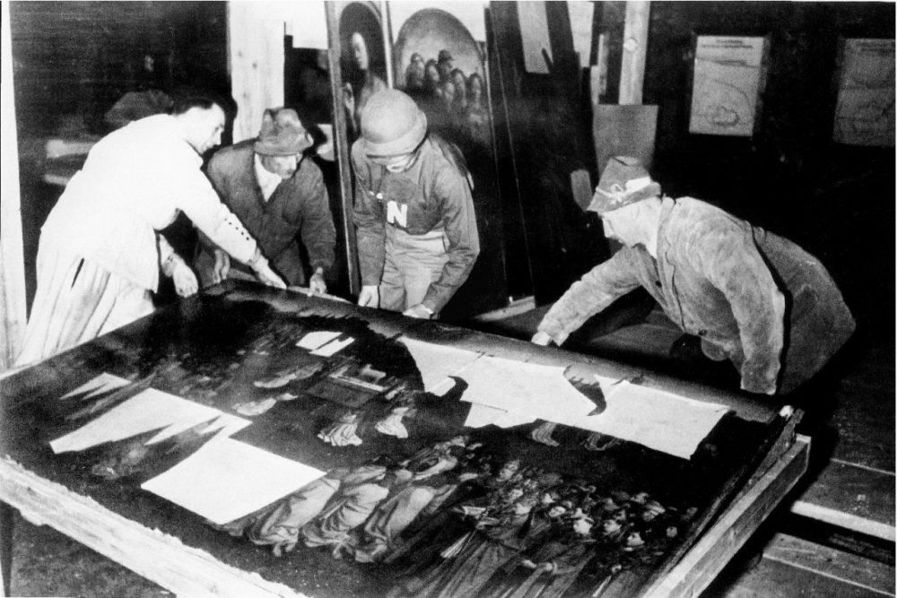 Monuments Man George Stout moves the central panel of the Ghent Altarpiece in Altaussee, Austria in July of 1945. (National Archives and Records Administration/AP)