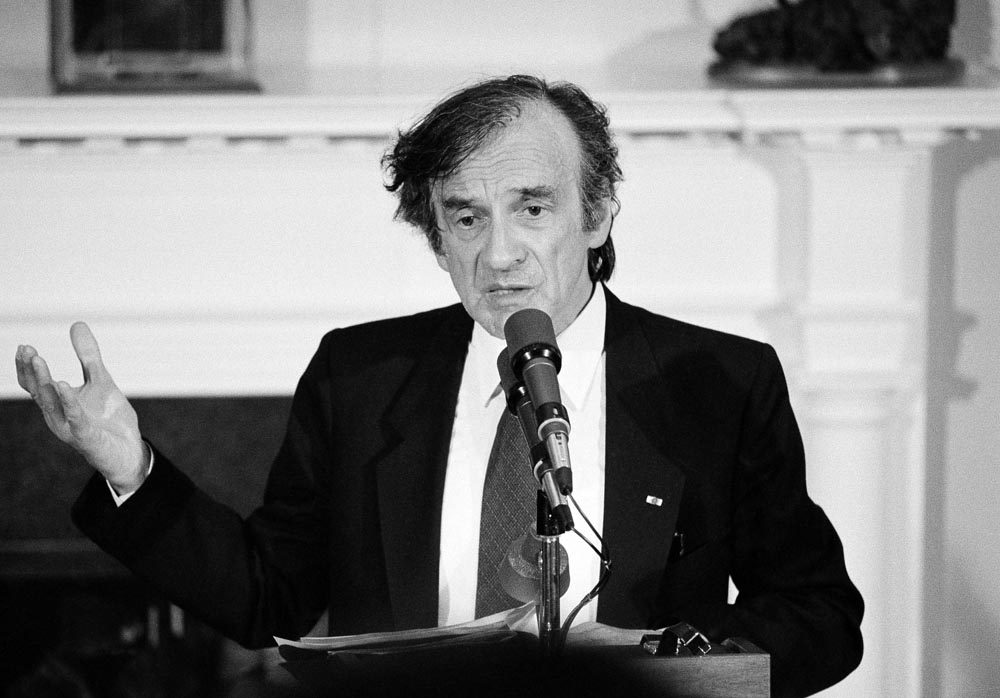 In a speech during a 1985 White House ceremony in which he was presented with the Congressional Gold Medal, Elie Wiesel pleaded with President Ronald Reagan to abandon a scheduled stop at a military cemetery during his coming visit to Germany. (AP)