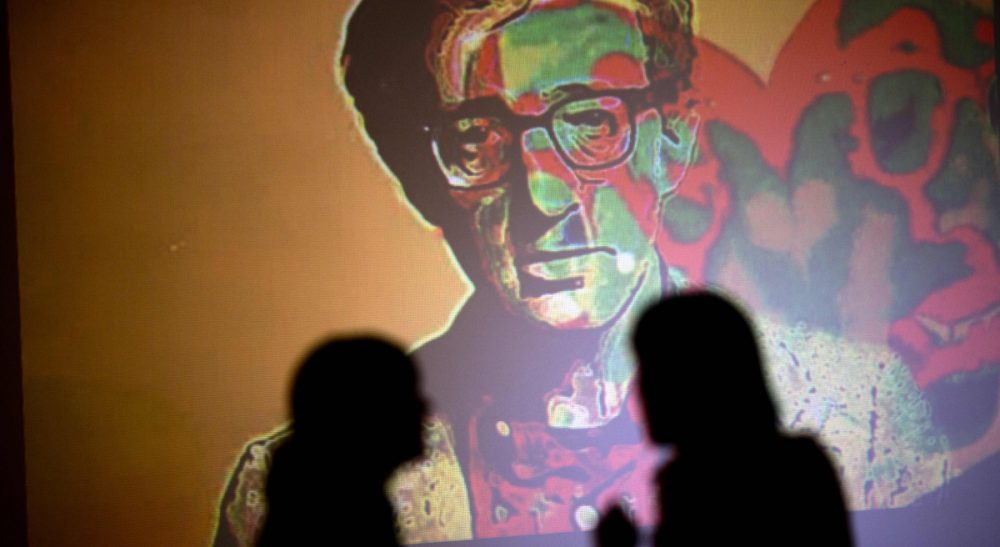 """Janna Malamud Smith: Should we care? Yes. But mostly because the public importance of this tale is separate from the people involved. In this photo, an image of Woody Allen is projected on a wall at an art exhibit titled """"Queremos tanto a Woody,"""" or """"We so love Woody"""" by Argentine artist Hugo Echarri in Buenos Aires, Argentina, Thursday, Feb. 6, 2014. The exhibit in honor of Allen was inaugurated just days after the artist faced renewed accusations that he molested Dylan Farrow, his then-7-year-old adopted daughter in 1992. (Rodrigo Abd/AP)"""