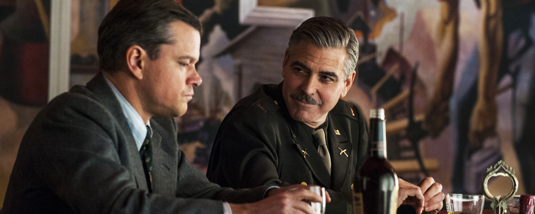 """This film image released by Columbia Pictures shows Matt Damon, left, and George Clooney in """"The Monuments Men."""" A spokesman for Sony Pictures said Wednesday, Oct. 23, 2013, that the film will now be released in the first quarter of next year, instead of its planned release date of Dec. 18. """"Monuments Men,"""" which Clooney directed, co-wrote and stars in, had been expected to be a top Oscar contender. (Claudette Barius/Sony/AP Photo/Columbia Pictures)"""