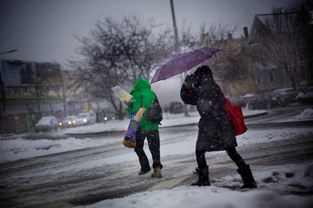 Bostonians struggle through a snowstorm February 13, 2014. (Jesse Costa/WBUR)
