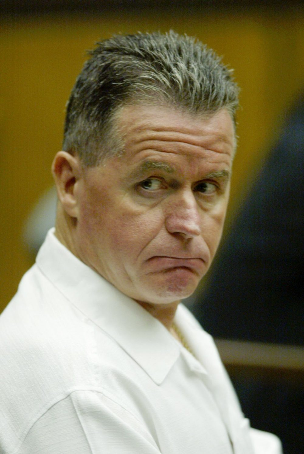 In this AP file photo, Fred Weichel, then 50, sits in court in 2003. He is serving a life sentence for a 1980 murder. (Julia Malakie/AP)
