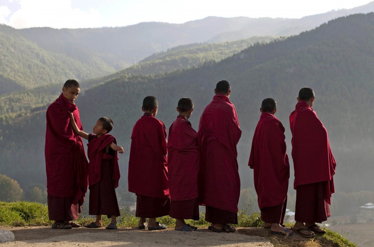Bhutanese novice Buddhist monks stand outside a monastery in the capital of Thimphu, Bhutan. (Kevin Frayer/AP)