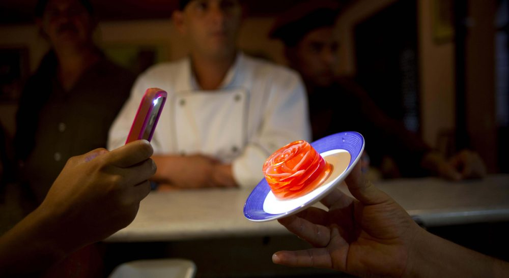 Remember when food was just something you ate? In this Oct 18, 2013 photo, a chef holds up a 3D gelatin flower dessert in Havana, Cuba. (Ramon Espinosa/AP)