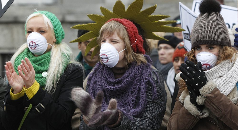 Passionate pursuit of our beliefs feels great, but can blind us to common sense. It happens to environmentalists on the left as much as to climate deniers on the right. In this photo, demonstrators protest a coal industry meeting in front of the Polish Ministry of Economy in Warsaw, Monday Nov. 18, 2013. (Czarek Sokolowski/AP)
