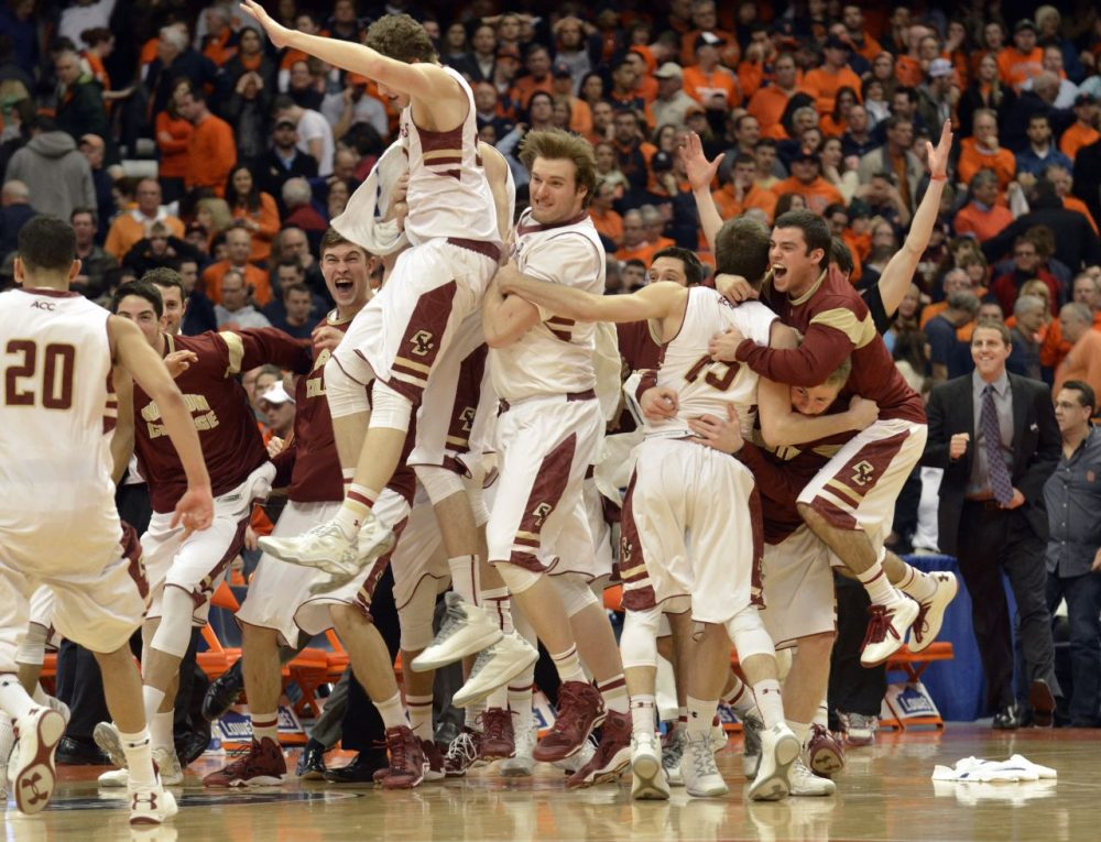 Boston College players celebrate after defeating Syracuse 62-59 in overtime . (Kevin Rivoli/AP)