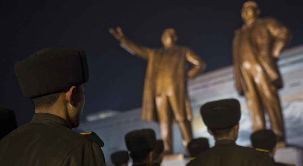 North Korean soldiers gather to pay their respects at the base of statues of the late leaders Kim Il Sung and Kim Jong Il at Mansu Hill in Pyongyang, North Korea, Monday, Dec. 16, 2013, the eve of the second anniversary of the death of Kim Jong Il. (David Guttenfelder/AP)