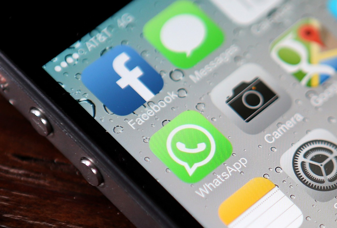 The Facebook and WhatsApp app icons are displayed on an iPhone on February 19, 2014 in San Francisco. (Justin Sullivan/Getty Images)