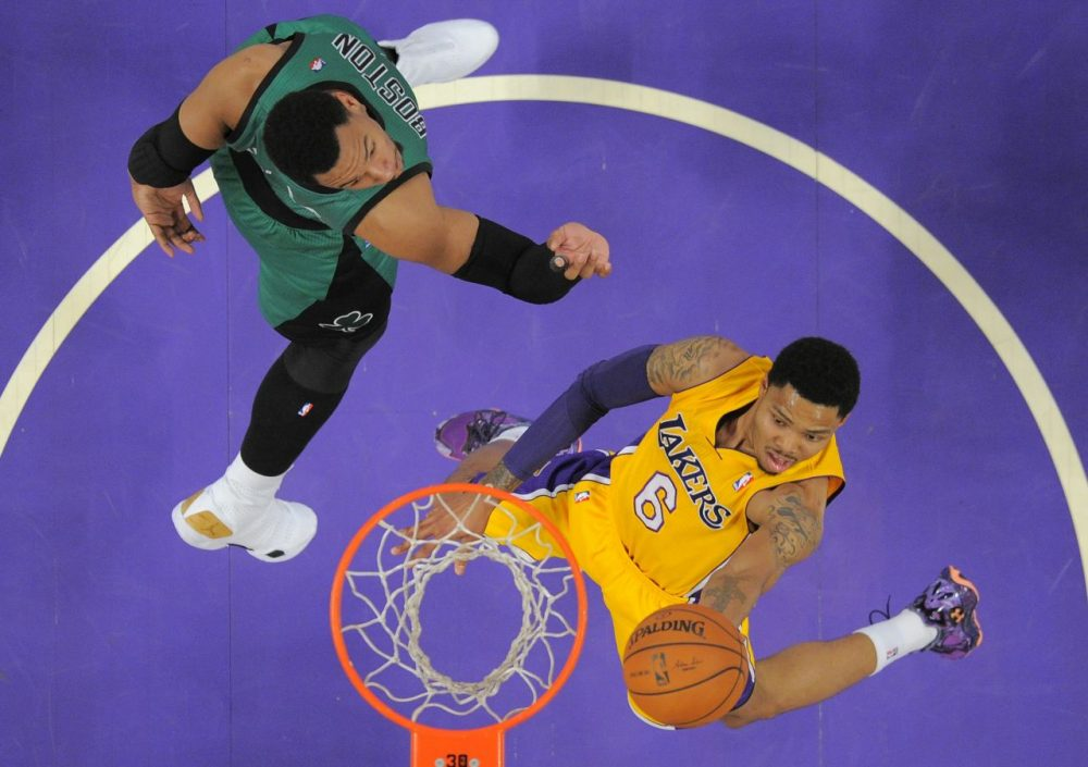 Los Angeles Lakers guard Kent Bazemore, right, goes up for a shot as Boston Celtics center Jared Sullinger defends during the first half of an NBA basketball game in Los Angeles. (Mark J. Terrill/AP)
