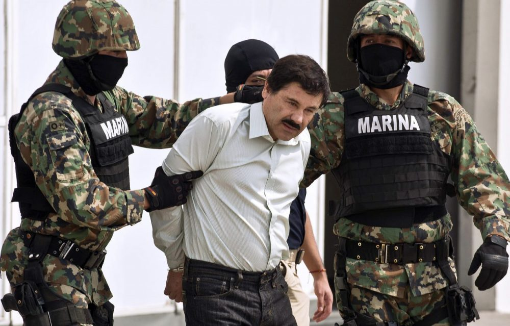 "Mexican drug trafficker Joaquin Guzman Loera aka ""el Chapo"" Guzman"" is escorted by marines as he is presented to the press on February 22, 2014 in Mexico City. (Ronaldo Schemidt/AFP/Getty Images)"