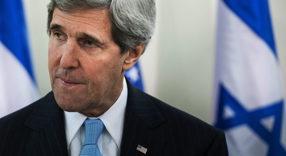 "U.S. Secretary of State John Kerry speaking before a meeting with Israeli Prime Minister Benjamin Netanyahu in  Jerusalem, Thursday, Jan. 2, 2014. Kerry has said that finding peace between Israel and the Palestinians is not ""mission impossible."" (Brendan Smialowski/AP)"