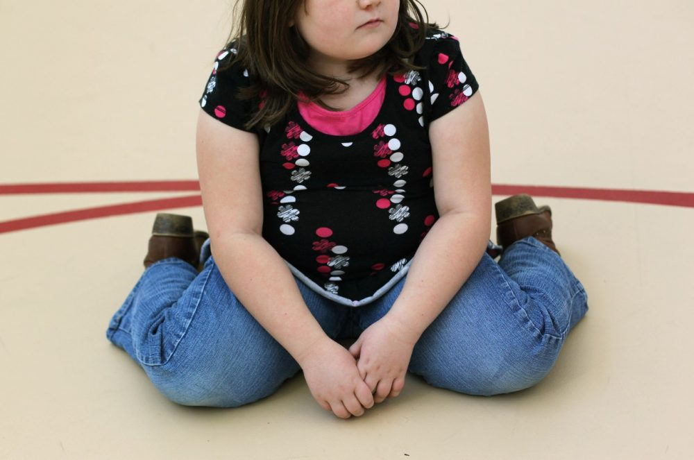 A child sits on the gym floor during the Shapedown program for overweight adolescents and children on November 13, 2010 in Aurora, Colorado. (John Moore/Getty Images)