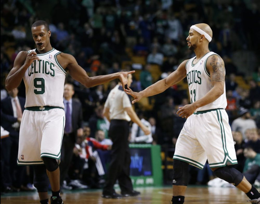 Boston Celtics guard Rajon Rondo (9) celebrates with teammate Jerryd Bayless during a timeout late in the fourth quarter.(AP/Elise Amendola)