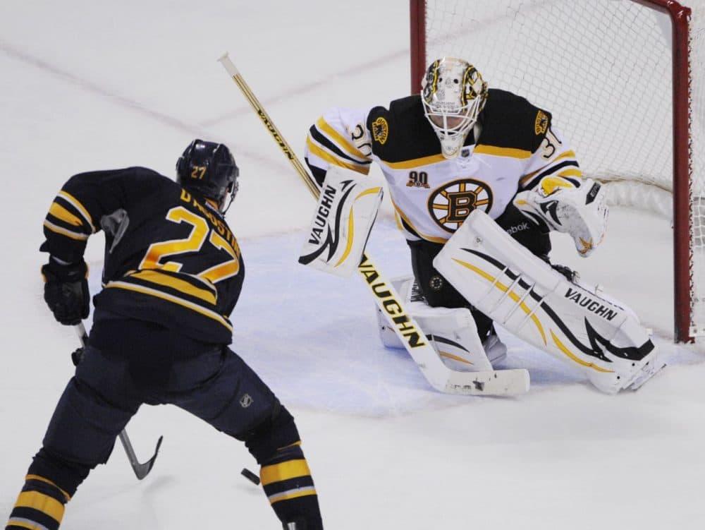 Buffalo Sabres' Matt D'Agostini (27) moves in to score the game-winning goal on Boston Bruins' Chad Johnson (30) during overtime. (AP/Gary Wiepert)