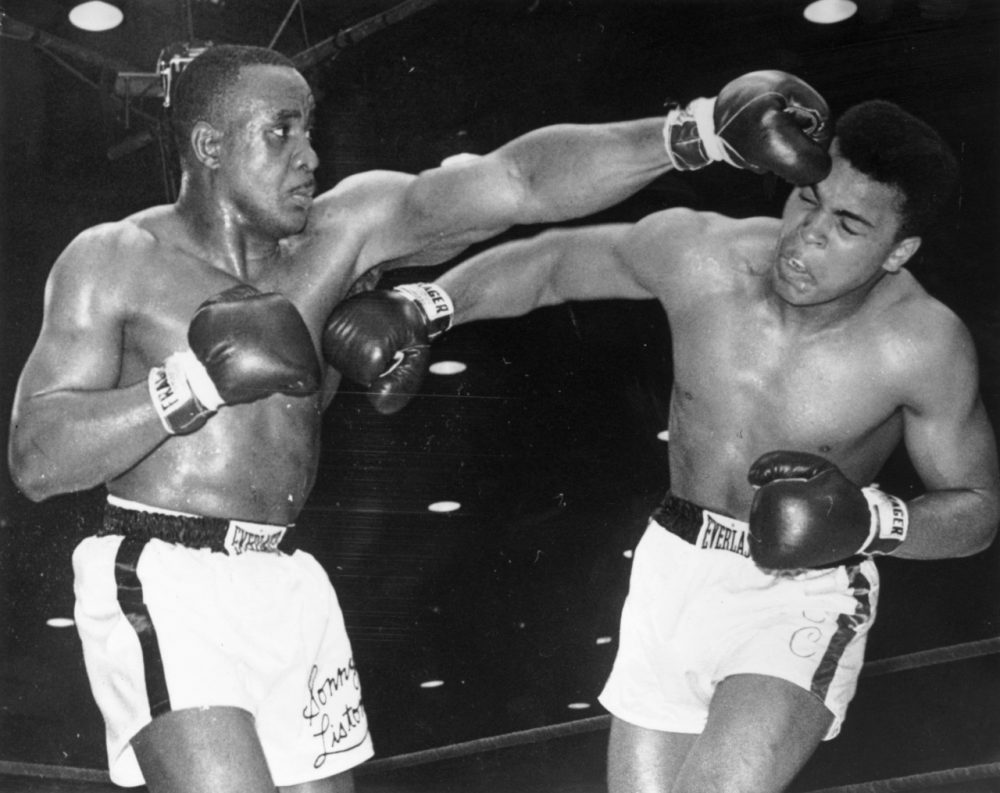 Muhammed Ali lands a punch on Liston's body and ends up taking home the title. (Central Press/Getty Images)