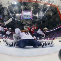 Marie-Philip Poulin of Canada (29) scores past USA goalkeeper Jessie Vetter (31) during the women's gold medal ice hockey game, Thursday, Feb. 20, 2014, in Sochi, Russia. (Mark Blinch/AP)