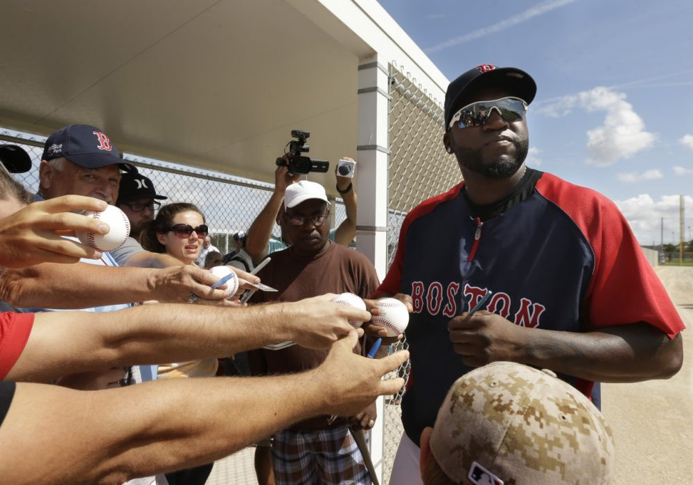Boston Red Sox designated hitter David Ortiz signs autographs during spring training baseball practice, Sunday, Feb. 23, 2014, in Fort Myers, Fla. (AP)