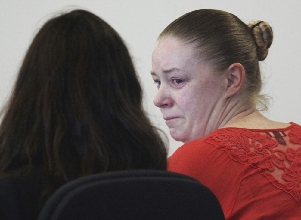 Aisling Brady McCarthy, right, from Quincy, Mass., sits with her attorney during a hearing in Middlesex Superior Court on Sept. 3, 2013. (Wendy Maeda/The Boston Globe/AP/Pool)