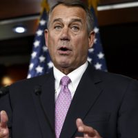 "In this Feb. 6, 2014 file photo, House Speaker John Boehner of Ohio speaks during a news conference on Capitol Hill in Washington. In a concession to President Barack Obama and Democratic lawmakers, Boehner said the House would vote to increase the government's borrowing cap without trying to attach conditions sought by some Republicans. ""We'll let his party give him the debt ceiling increase that he wants,"" Boehner said, hours before the vote. (Scott Applewhite/AP)"