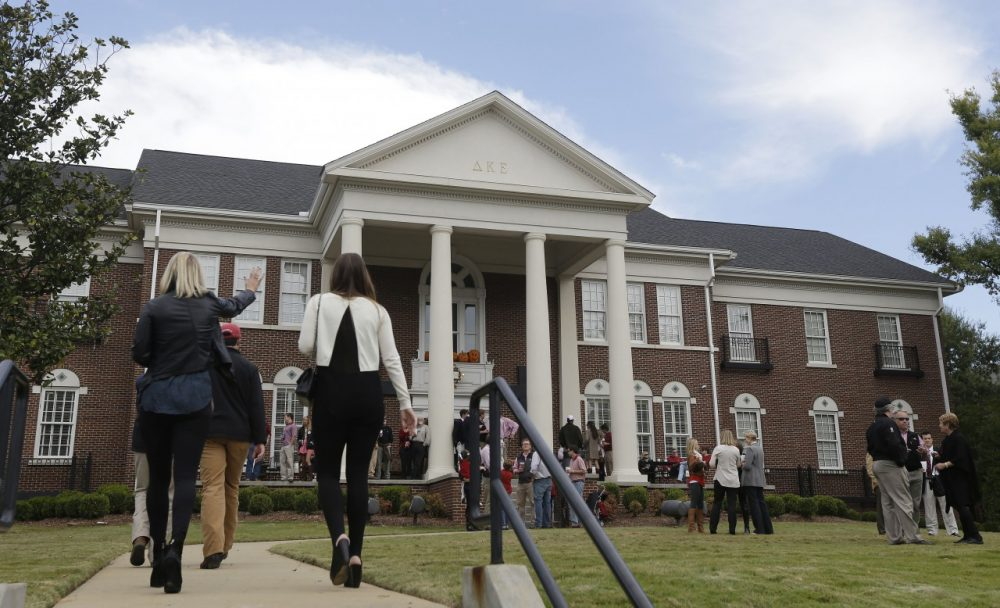 In this photo taken Oct. 26, 2013, guests and residents of the Delta Kappa Epsilon fraternity gather on the lawn prior to an NCAA college football game in Tuscaloosa, Ala. (AP)