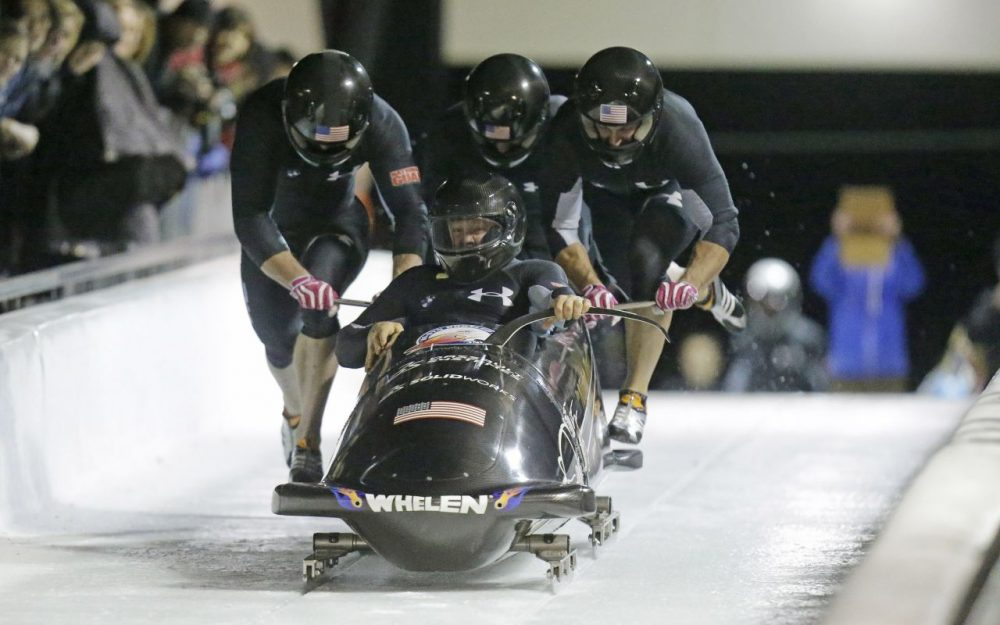 From front to back, Steve Holcomb, Curt Tomasevicz, Steve Langton, Chris Fogt climb in to their sled during the United States four-man bobsled team trials Friday, Oct. 25, 2013, in Park City, Utah. (Rick Bowmer/AP)