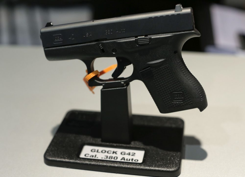 The Glock G42, .380 caliber Auto hand gun sits on display at the Glock display booth during the Shooting Hunting and Outdoor Trade Show, Tuesday, Jan. 14, 2014, in Las Vegas. (AP)