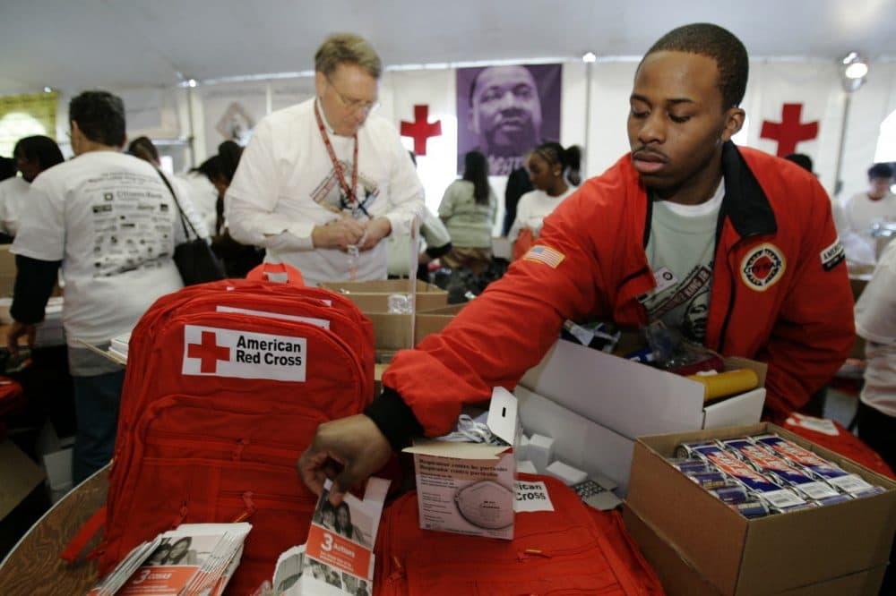 City Year Corps member Leon McClain helps assemble emergency preparedness backpack kits in Philadelphia. (AP/Matt Rourke)