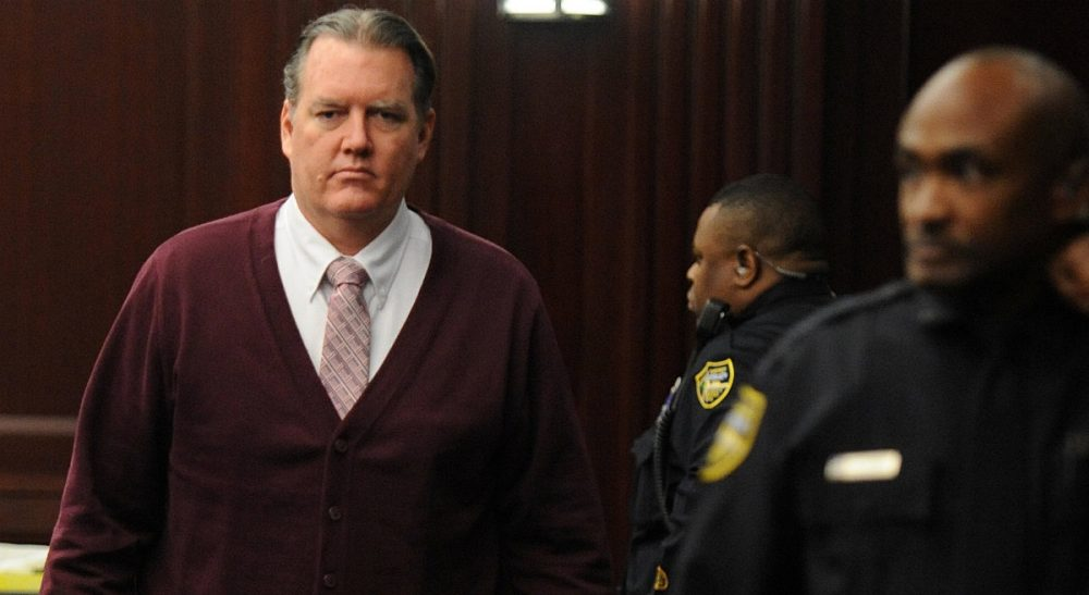 Michael Dunn returns to the courtroom during jury deliberations in his trial in Jacksonville, Fla., Thursday Feb. 13, 2014. Dunn was convicted of attempted murder in the shooting death of a teenager during an argument over loud music, but jurors could not agree on the most serious charge of first-degree murder. (Bob Mack/AP)