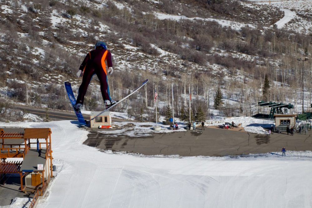 Jessica Jerome launches off of the hill during a practice run in Park City, Utah. (Brian Grimmett/Only A Game)