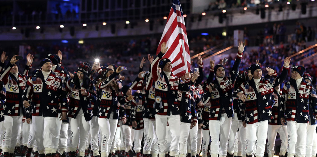 Todd Lodwick of the United States carries the national flag as he leads his team into the stadium during the opening ceremony of the 2014 Winter Olympics in Sochi, Russia, Friday, Feb. 7, 2014. (AP Photo/Patrick Semansky)