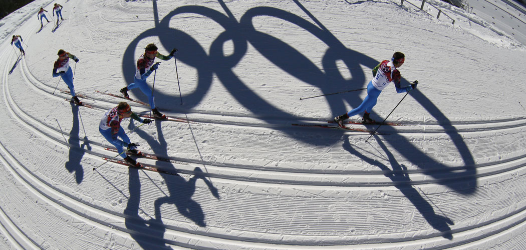 Athlete pass by the Olympic rings as they train on the cross-country track prior to the 2014 Sochi winter games, Thursday, Feb. 6, 2014, in Krasnaya Polyana, Russia. (AP Photo/Dmitry Lovetsky)